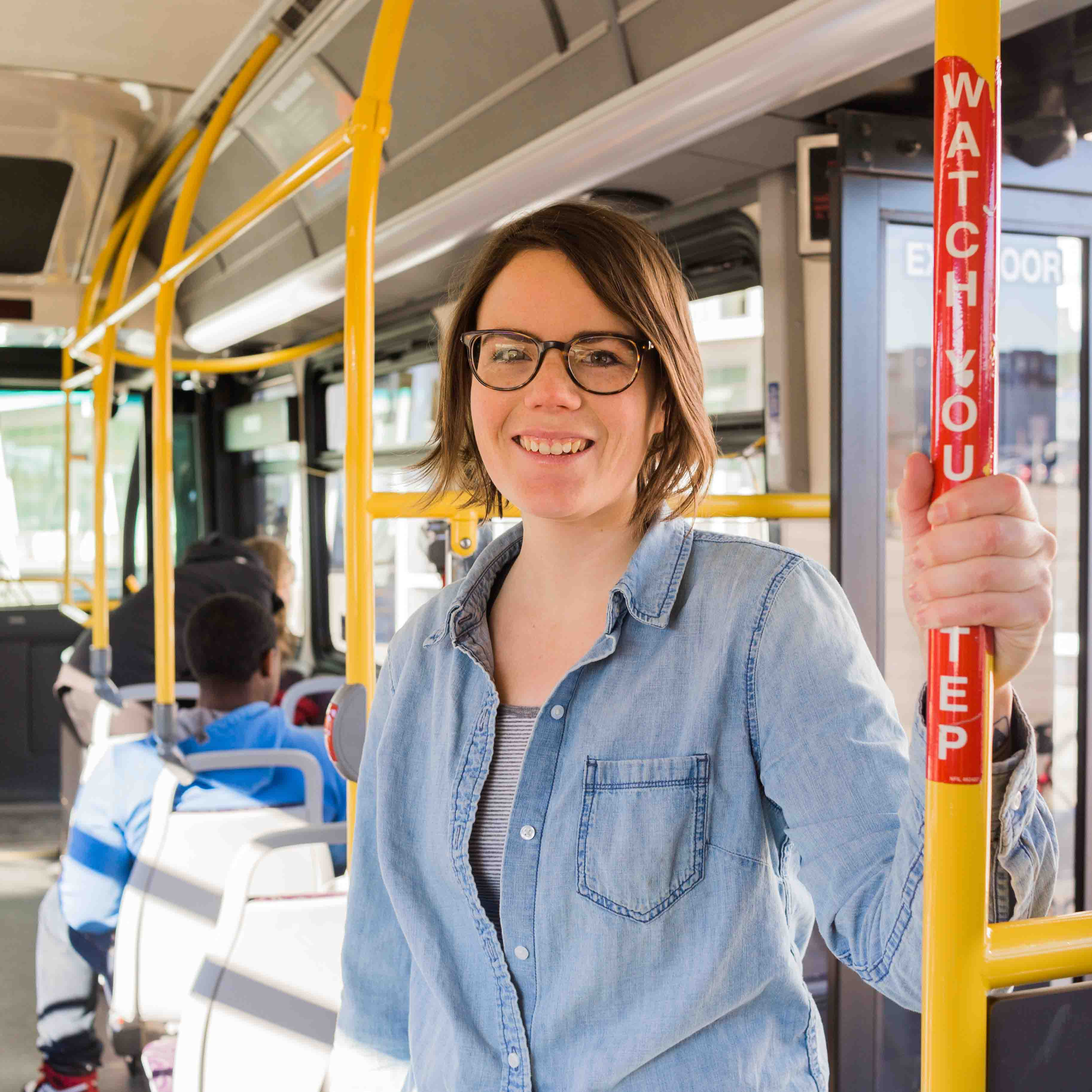 Photo of DART rider Kerri on a DART bus.